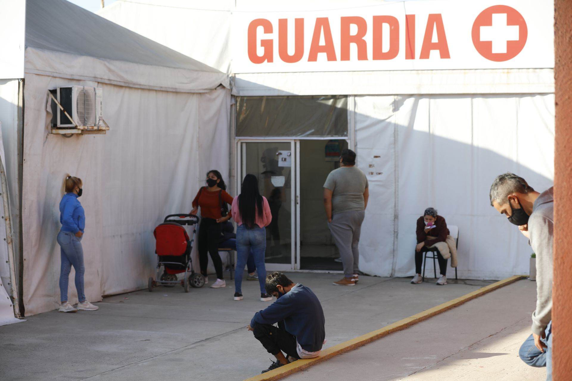 They wait at the Guardia Domingo Anggio Municipal Hospital in the town of José C Paz