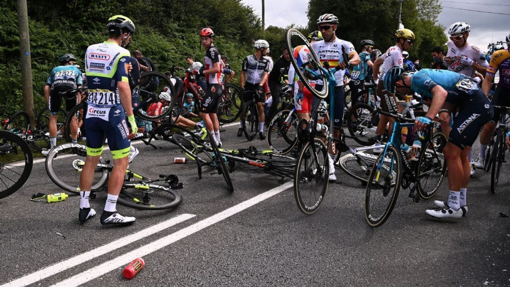 A spectator who caused a fall during the first stage of the Tour de France has been arrested