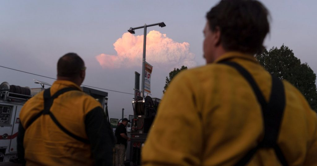 A large wildfire is growing in the United States and forcing new evacuations
