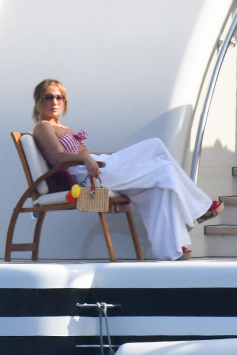 Jennifer Lopez wears a navy and red striped blouse on vacation with Ben Affleck