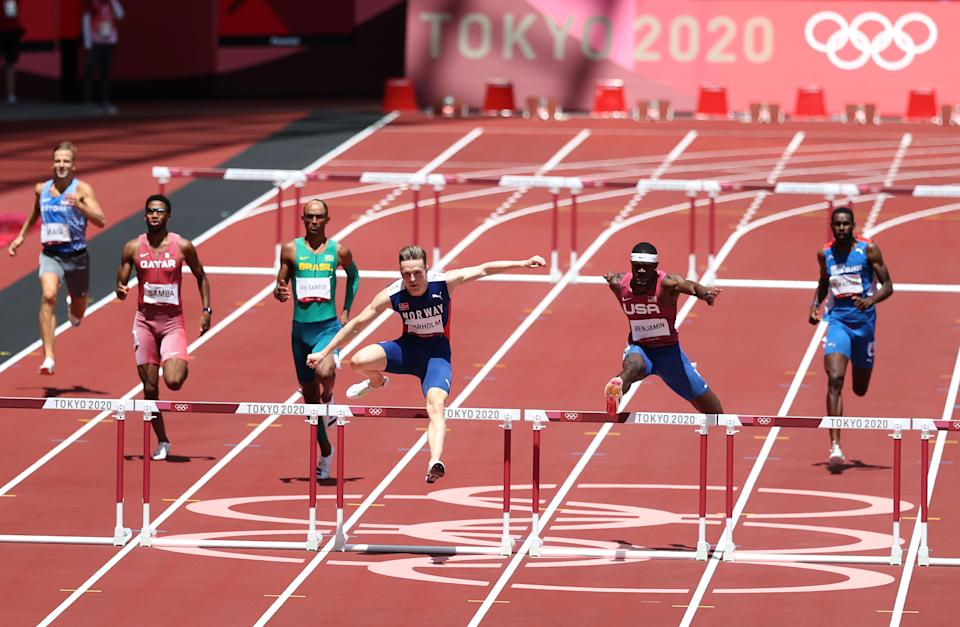 TOKYO, JAPAN - AUGUST 03: Karsten Warholm of Team Norway and Ray Benjamin of Team USA compete in the men's 400m hurdles final on day 11 of the Tokyo 2020 Olympic Games at the Olympic Stadium on August 3, 2021 in Tokyo, Japan.  (Photo by Christian Petersen/Getty Images)
