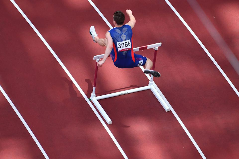 An overview shows Norway's Carsten Warholm competing in the men's 400m hurdles final during the Tokyo 2020 Olympic Games at the Olympic Stadium in Tokyo on August 3, 2021 (Photo by Antonin Thueler/AFP) (Photo by Antonin Thueler/AFP via Getty Images)
