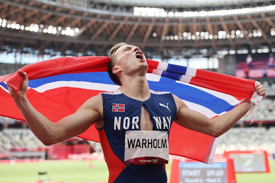 TOKYO, JAPAN - AUGUST 03: Karsten Warholm of Team Norway responds after winning the gold medal in the men's 400m hurdles final on day 11 of the Tokyo 2020 Olympics at the Olympic Stadium on August 3, 2021 in Tokyo, Japan.  (Photo by Patrick Smith/Getty Images)