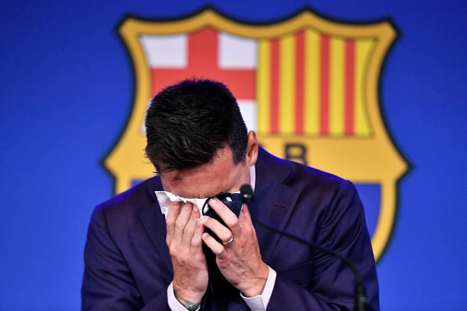 Top Shot - Barcelona Argentine striker Lionel Messi cries during a press conference at the Camp Nou stadium in Barcelona on August 8, 2021. - He was expected to sign the ball six times or win Messi with a new five-year contract with Barcelona on August 5, but instead of That, after 788 matches, the club announced his departure at the age of 34 (Photo by Pau Barina/AFP) (Photo by Pau Barina/AFP via Getty Images)
