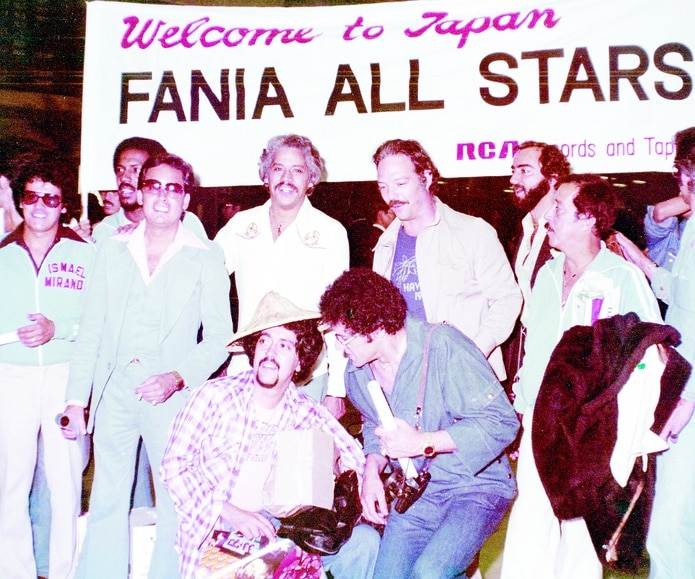 Supplied with Vanya Stars in Japan.  From left, Ismael Miranda, Roberto Rowena (back), Ismael Quintana, Johnny Pacheco, Larry Harlow, Jerry Masucci, Santitos Colon and Jose Flores.  In the foreground, Nikki Marrero (hat) and Izzy Sanabria.  ------