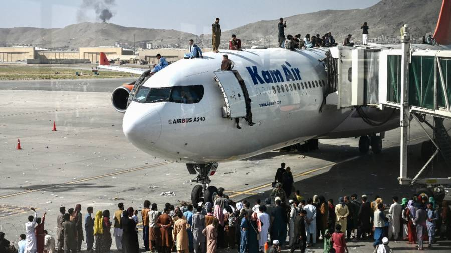 VIDEO: Afghan man taps plane wing as he tries to escape Taliban