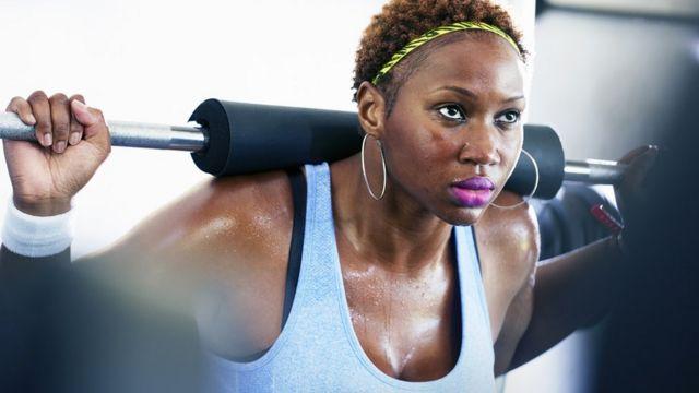 woman exercising.