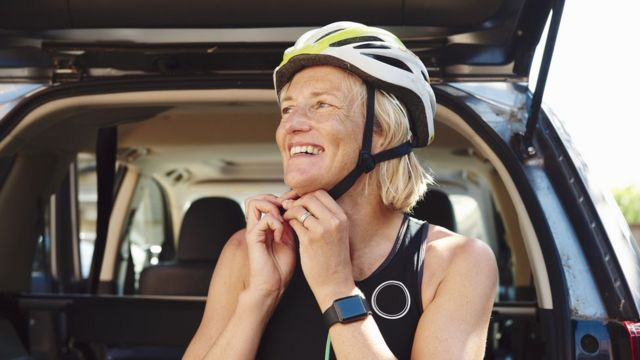 A woman wearing a bicycle helmet.